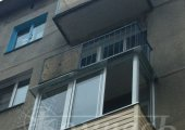 Алюминиевое остекление балкона и сайдинг