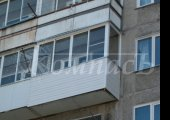 Г-образное остекление балкона